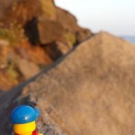 Lego man on a hike.